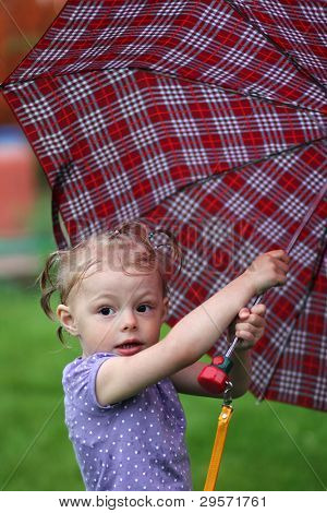 little girl with a umbrella in park