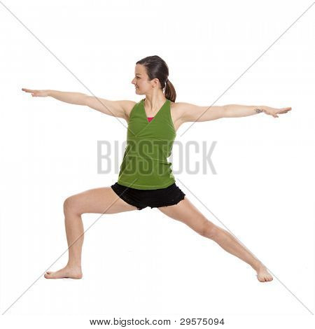 woman doing yoga, warrior position, with clipping path