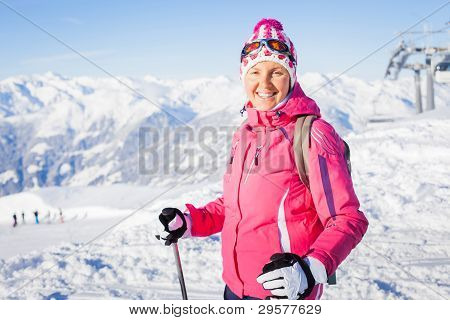 Young woman with skis and a ski wear