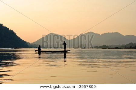 Fishers On River With Sunset