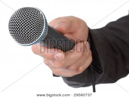 Mans hand holding a microphone conducting an interview