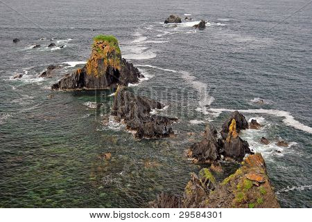 Jagged Rocks On The Ocean Coast