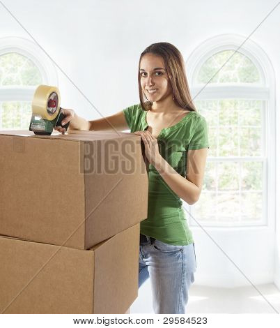 Young Woman Moving To A New Home