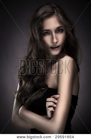 young brunette woman beauty portrait studio shot