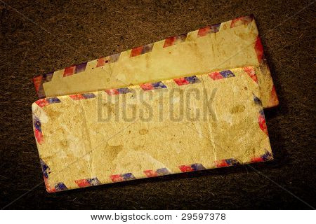 Vintage two old airmail envelope on a dark background