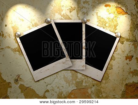 Three empty grunge frame for your photo on the old wall with lighting