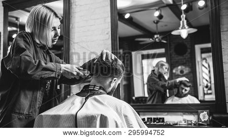 poster of Young Woman Making Haircut For Bearded Man At Barbershop. Female Barber At Salon. Gender Equality. W