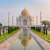 Out Of Focus Of Taj Mahal Front View Reflected On The Reflection Pool, An Ivory-white Marble Mausole poster