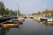 stock photo of pontoon boat  - boats moored on a canal in Harlingen - JPG