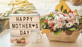 Happy Mothers Day. A Beautiful Bouquet Of Flowers With Hot Tea On The Table. Breakfast In Bed On Mot poster