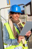 Architect on building site using electronic tablet