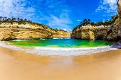 The ocean fjord closed on three sides of Pacific ocean. The Great Ocean Road of Australia. The conce poster