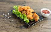 Crispy Kentucky Fried Chicken In A Wooden Table - Junk Food And Unhealthy Food.  Breaded Crispy Spic poster