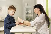 Mother - Nurse Teaches Little Son To Disinfect Wounds In Cuts. Learning In A Playful Way. Child At W poster