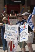 Jewish Reverlers Hold Up Up Placards In Support Of Gay Rights At The Toronto Gay Pride Festival