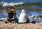 picture of beach party  - Mother and baby carriage on the beach - JPG