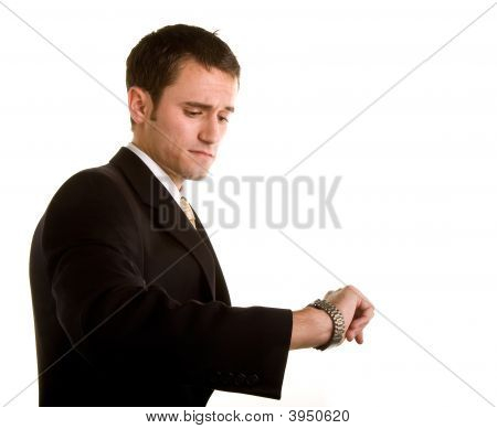Man In Suit Checking Watch Concerned