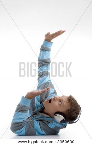 Laying Young Man With Headphone Looking Upside