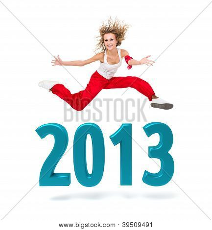 Woman Jumping Over A 2013 New Year Sign