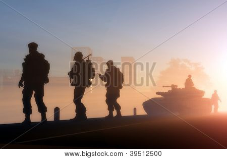 A group of soldiers against the dawn.