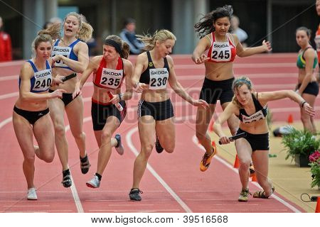 LINZ, AUSTRIA - FEBRUARY 25: Michaela Egger (#230, Austria) and her team place third in the women's 4x200m relay event in Linz, Austria on February 25, 2012.
