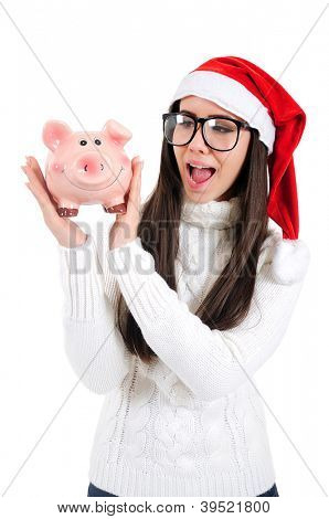Isolated Young Christmas Girl Holding Piggy Bank