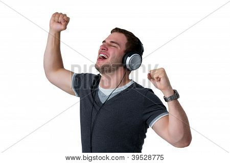 Young Man Listening To Music And Dancing