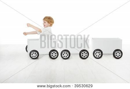 Child Driving Box Car And Empty Wagons. Delivery And Shipping Concept