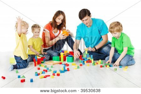 Happy Family. Parents With Three Kids Playing Toys Blocks Over White