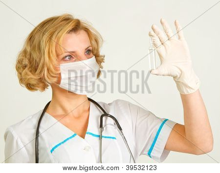 Young And Beautiful Doctor  In Gloves Showing Ampule