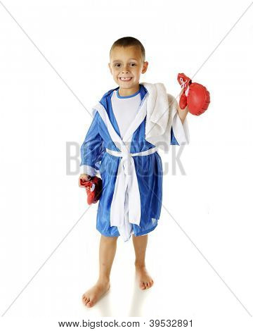 "An adorable preschool ""boxer"" with his robe on and his gloves off after the fight.  He's happy in spite of a black eye and missing tooth.  On a white background."