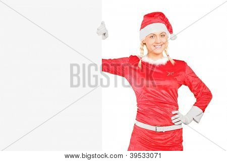 A sexy female in santa costume standing next to a blank billboard