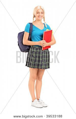 Full length portrait of a female student standing with school bag and holding books, isolated on white background