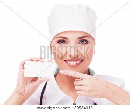portrait of woman doctor with a business card, isolated on white background