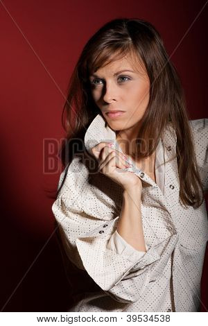 Sophisticated woman posing over red background