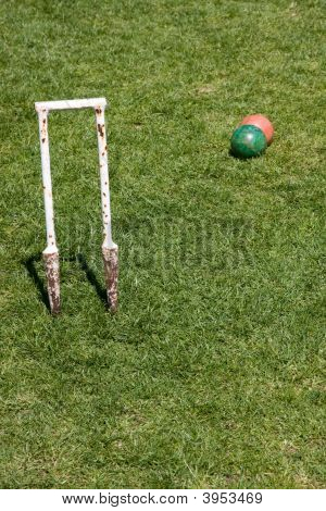 Well Used Croquet Hoop And Balls