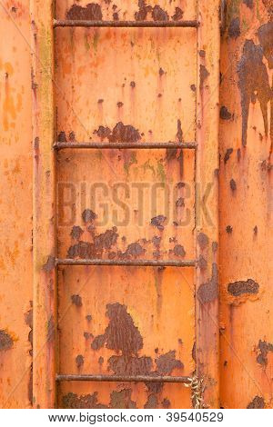 steps of old orange and rusty container on vertical image
