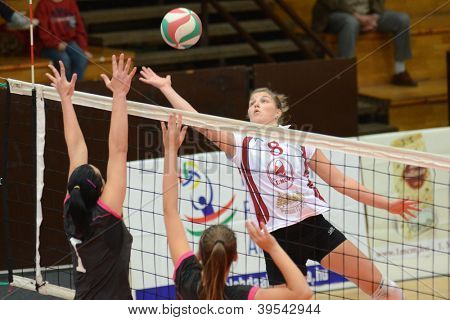 KAPOSVAR, HUNGARY - OCTOBER 14: Timea Kondor (R) in action at the Hungarian I. League volleyball game Kaposvar (white) vs Nyiregyhaza (black), October 14, 2012 in Kaposvar, Hungary.