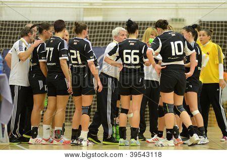 SIOFOK, HUNGARY - NOVEMBER 17: Siofok players listening to their trainer at EHF Cup handball match Siofok (black) (HUN) vs. Astrakhanochka (purple) (RUS) November 17, 2012 in Siofok, Hungary.