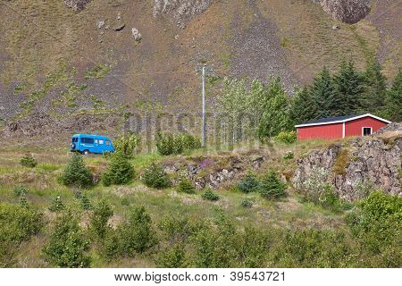 East Iceland Nature Landscape With House And Minibus