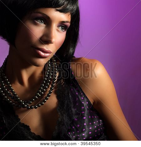 Picture of attractive brunet girl wearing stylish accessories, closeup portrait of pretty woman in glamorous black pearl beads, cute female with fashionable haircut, New Year party