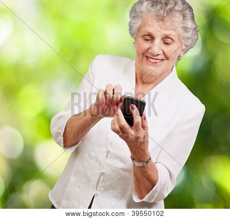 Senior woman with mobile phone, outdoor