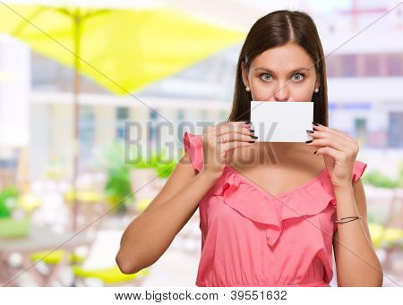 Woman Covering Her Mouth With Blank Placard, outdoor