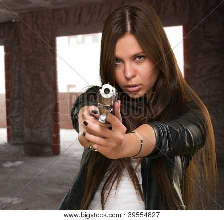 Portrait Of A Woman Holding Gun, indoor