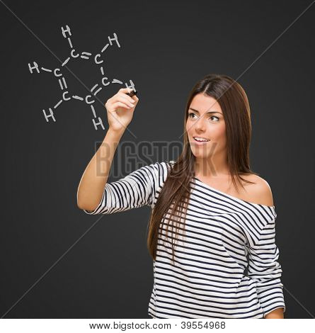 Young Woman Writing Chemical Equation Isolated On Black Background