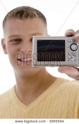 Happy Man Holding Digital Camera