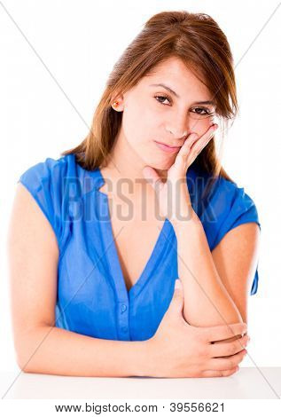 Bored woman looking very frustrated - isolated over a white background