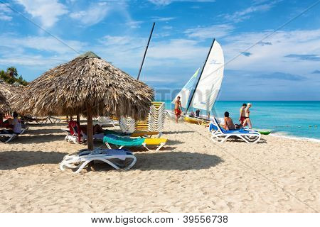 VARADERO,CUBA-NOVEMBER 3:Tourists enjoying the beach November 3,2012 in Varadero.With 50 hotels and about 20 000 rooms,Varadero is the main destination for tourists visiting Cuba