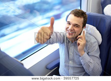 Young successful businessman in the train.