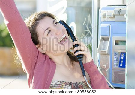 A Happy Woman Talking At Phone